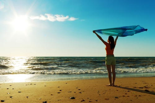 girl-woman-happy-sea-sun-beach-sand-sky
