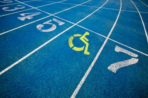 Handicap wheelchair icon superimposed on top of running track.