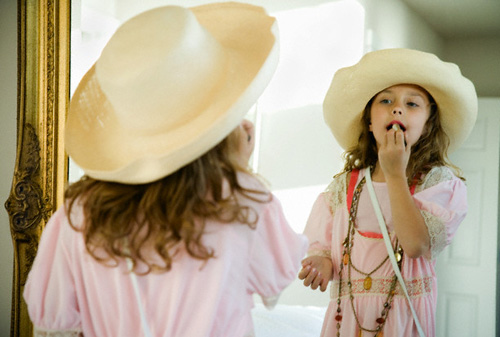 Girl Playing Dress Up --- Image by © Corbis